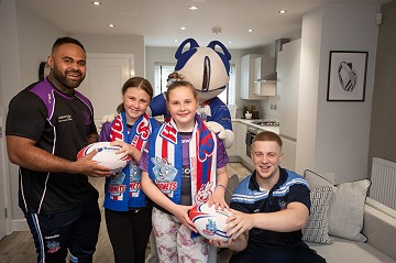 Picture of St Lukes pupils and Hornets players at Russell Homes' Cedar Gardens showhome opening