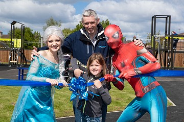 Photograph of ribbon cutting at Saltersford Gardens park