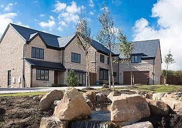 Stone-finished homes at Greenbooth Village