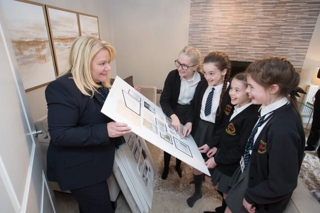 St Vincents' pupils view interior design 'mood boards' for the showhome with Sales Manager Gill Richardson